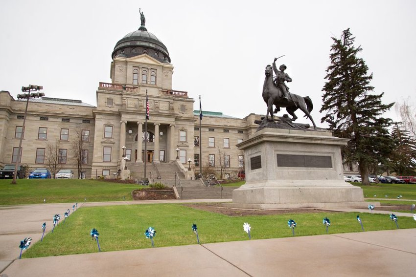 Street view of monument and capitol building in Helena, Montana