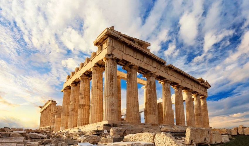 Ancient Greek Parthenon architecture seen under swirling white clouds, Greece