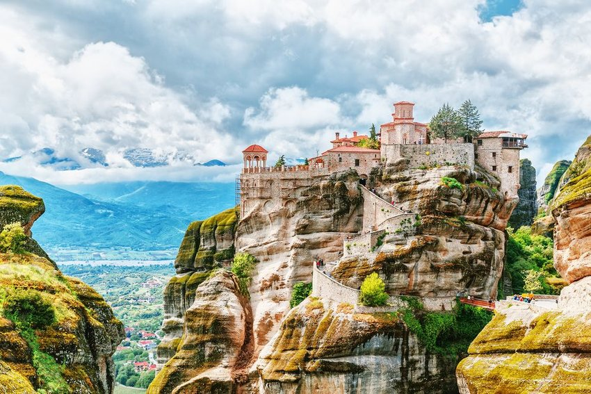 Aerial view of iconic Greek Monastary Meteora perched atop winding colorful cliffs