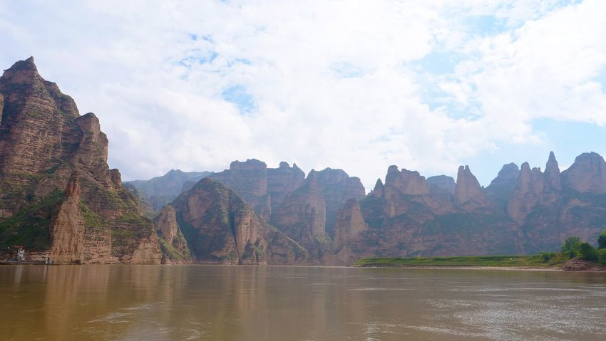 The Yellow River in China with rock formations in background