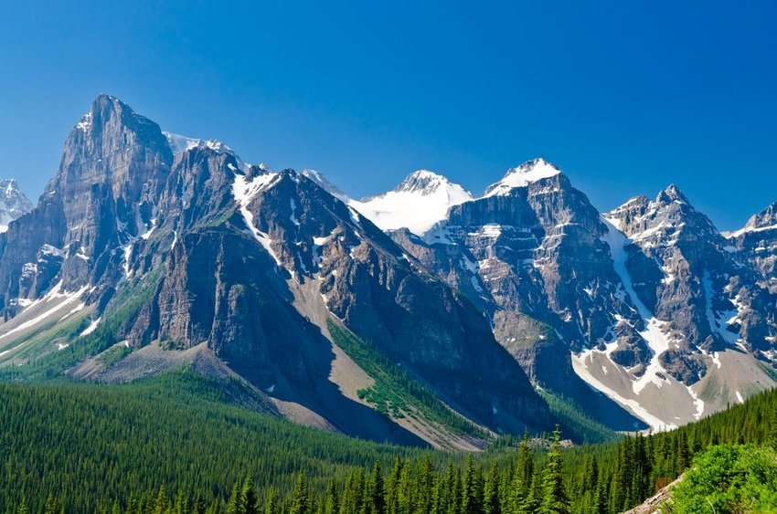 Rocky mountains with forests in front