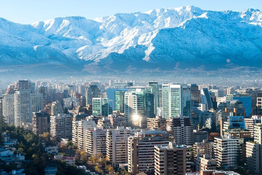 Aerial view of skyscrapers in Chile and huge mountains in background