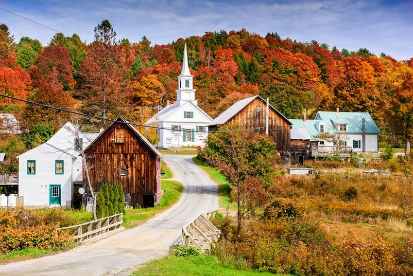Scenic New England landscape showing architecture and colorful fall foliage