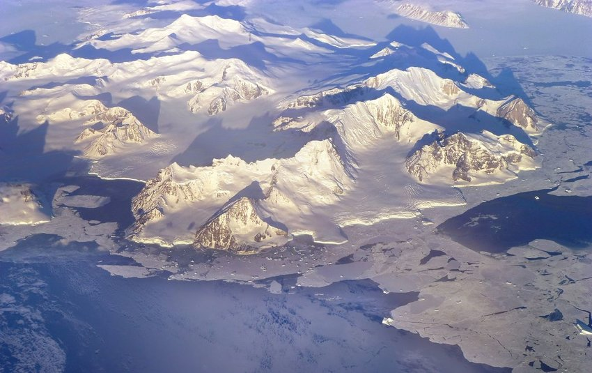 Aerial view of mountain ranges covered in snow and ice