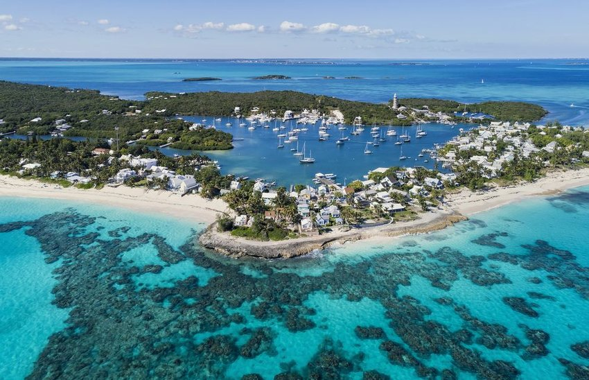 Aerial view of the harbour, beach and lighthouse in Hope Town on Elbow Cay, Abaco, Bahamas