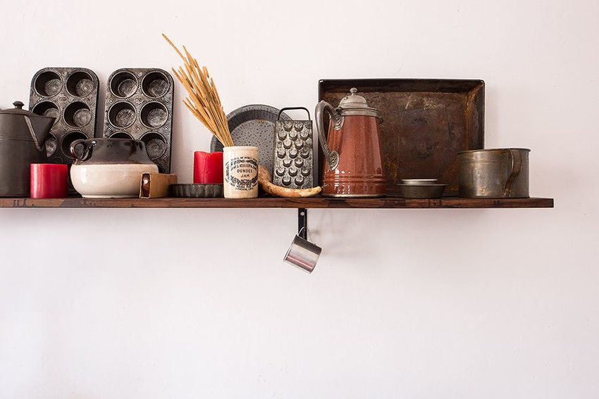 Baking and cooking utensils on a shelf