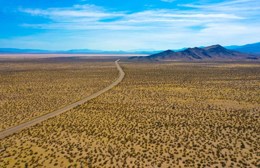 Aerial view of Death Valley with road running through landscape