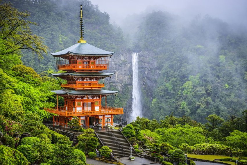 Temple of the Crossing of Blue Shore in Japan with Nachi Falls in the background
