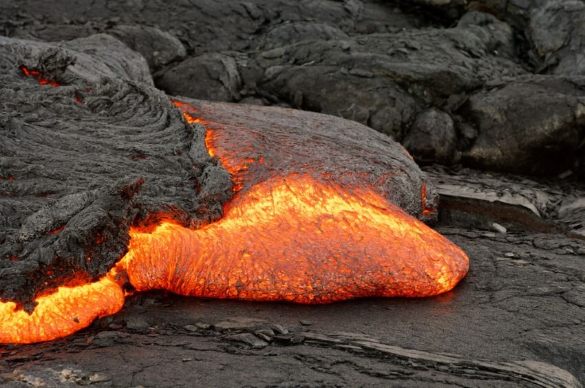 Active lava flow, hot magma emerges from a crack in the Earth.