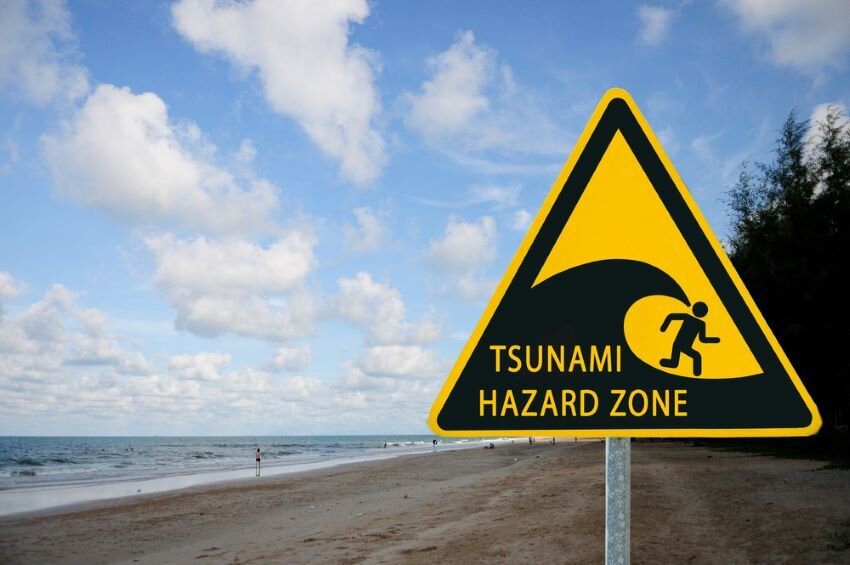 "Yellow sign ""Tsunami warning"" on Sea."