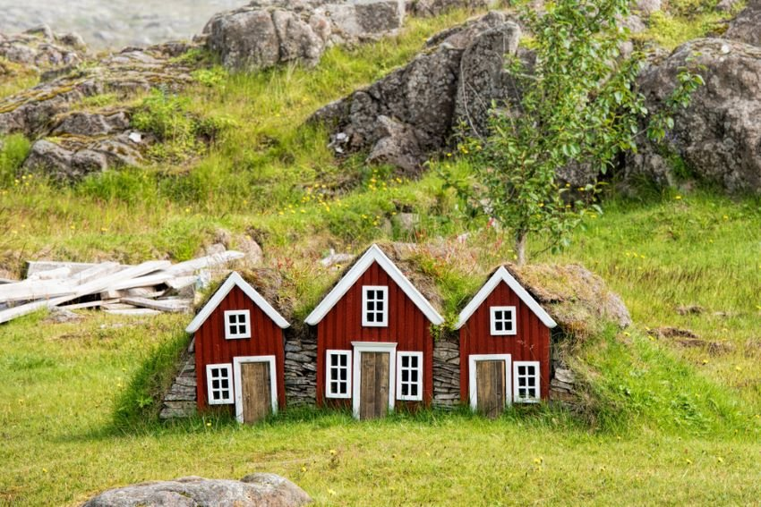 Small red elves' houses tucked into the countryside.