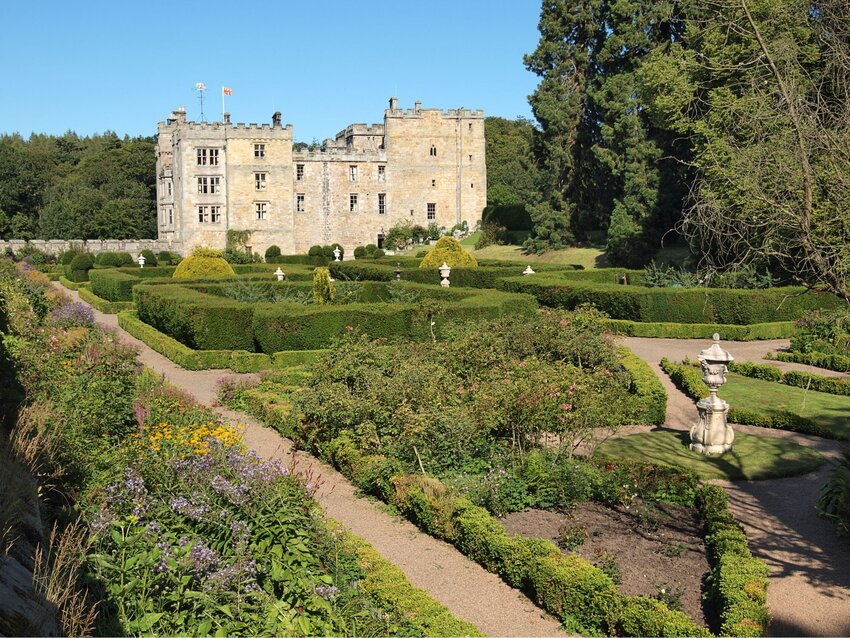 Chillingham Castle and manicured grounds