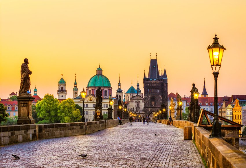 View across Charles Bridge at sunset with Old City in background
