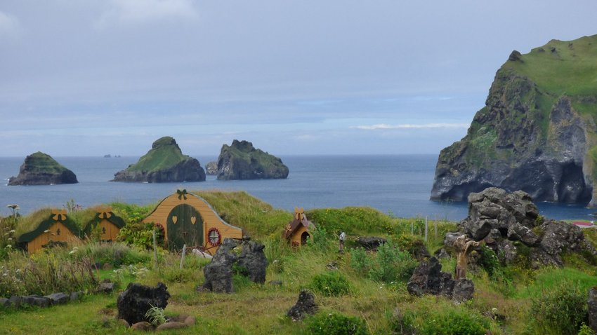 Elves' homes with sea bluffs in background