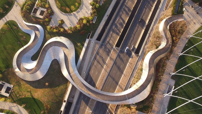Aerial view of BP Pedestrian Bridge snaking over Columbus Drive