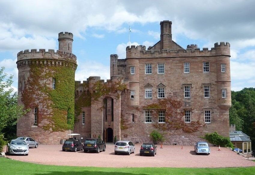 The front west-side of the Dalhousie Castle Hotel in England.