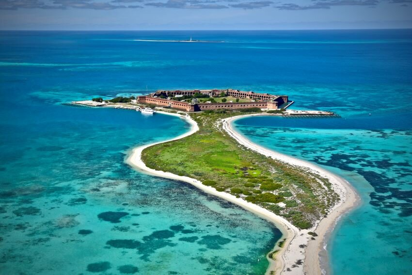 Aerial overview of turquoise waters and historic fort at Dry Tortugas National Park.
