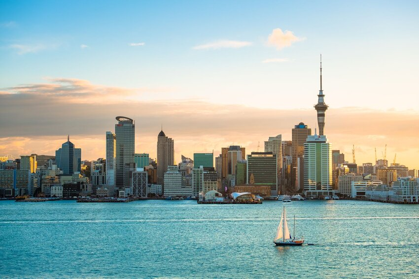 Waterfront skyline of Auckland, New Zealand with sailboat in front
