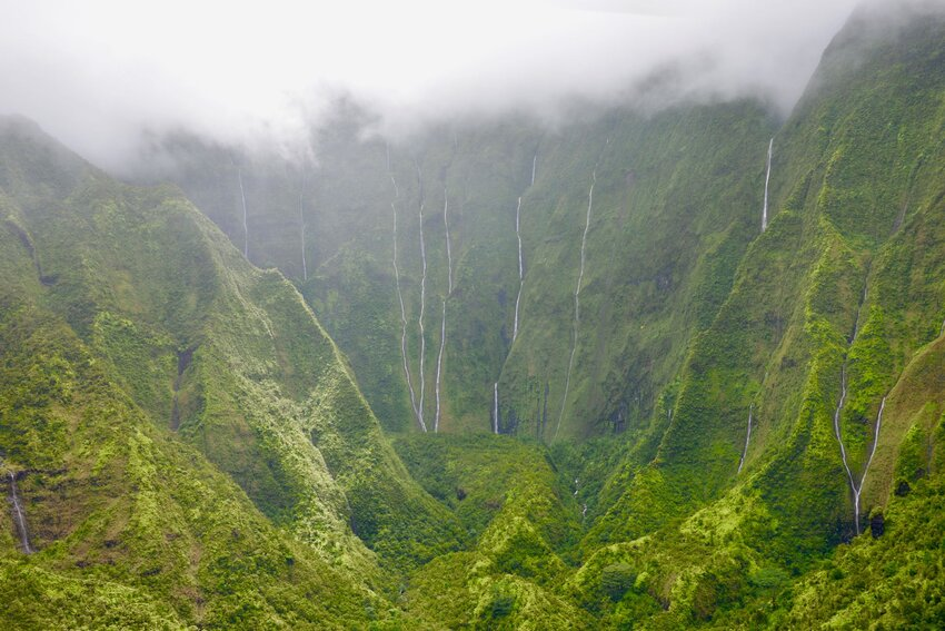 Lush green Weeping Wall of Kauai shrouded in mist
