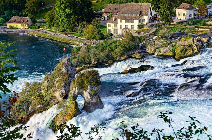 Aerial view of Rhine Falls with houses in Swiss houses background