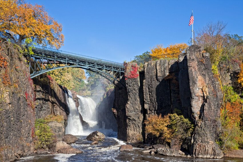 Footbridge over Passaic Falls surrounded by fall foliage