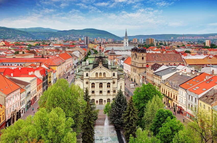 Aerial overview of Kosice, Slovakia, with church square and red-roofed buildings
