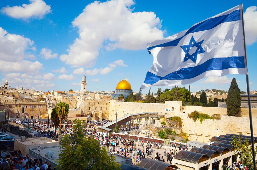 Western Wall in Jerusalem Old City with Israeli flag flying above