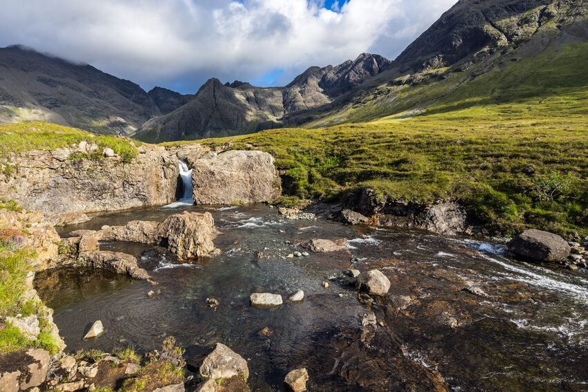Fairy Pools encircled by rocky Scottish highlands
