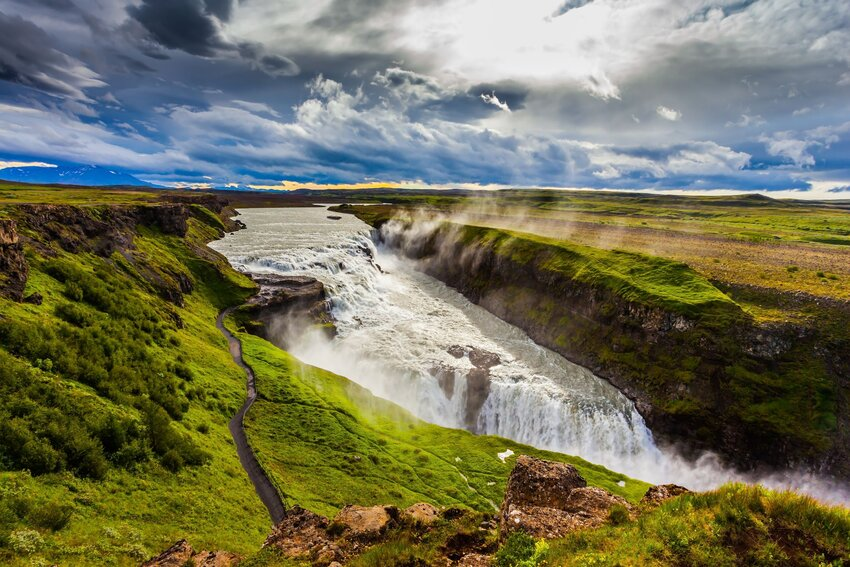 Overivew of Gullfoss with rugged, moss-covered Icelandic landscape