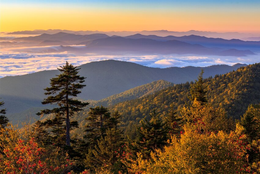 Looking from top of mountain peak at sun rising over Great Smoky Mountains Naitonal Park