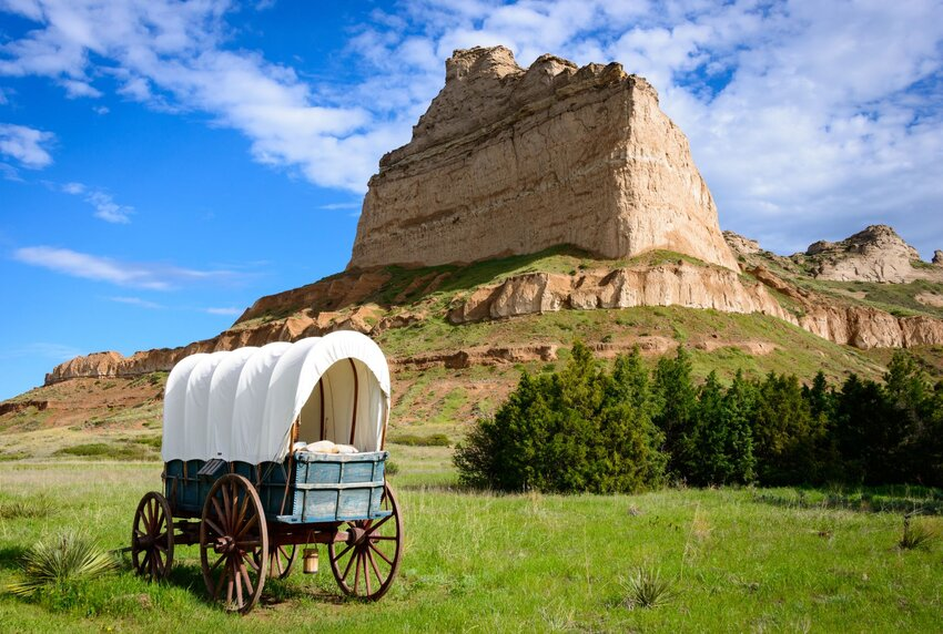 Scotts Bluff National Monument with covered wagon in foreground