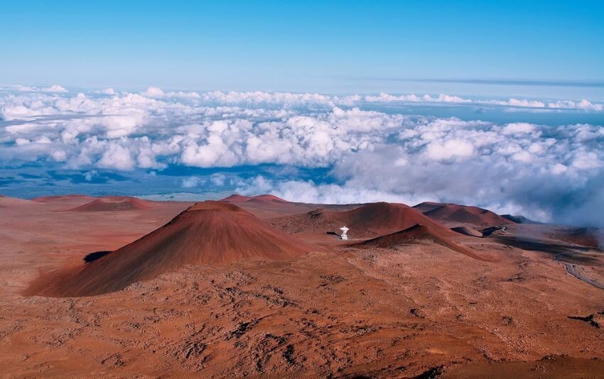 Extinct volcanic craters in background from Mauna Kea summit.