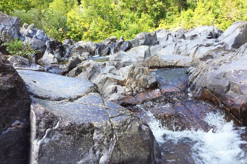 Water splashing on rocks at Johnson's shut ins state park in Missouri.