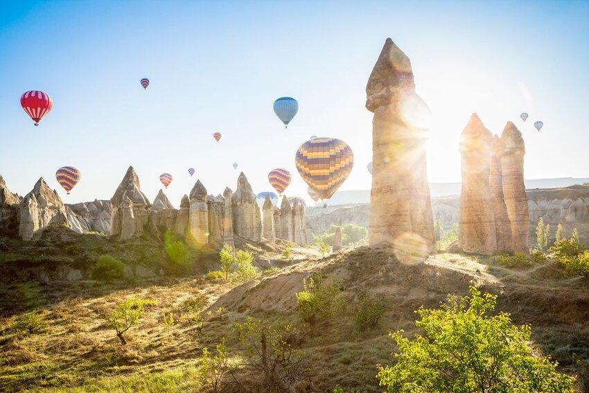 Hot air balloons over Love Valley near Goreme in the center of Cappadocia, Turkey.