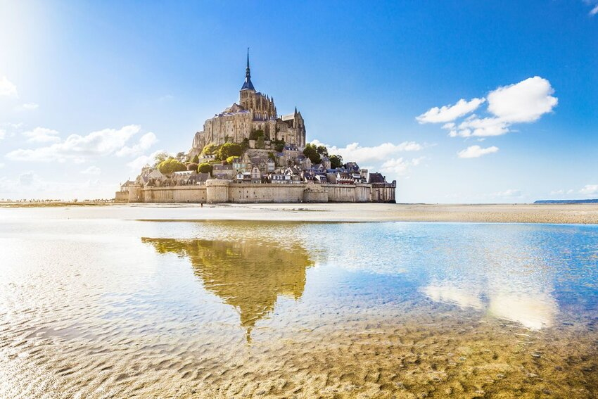 Panoramic view of famous Le Mont Saint-Michel tidal island on a sunny day.