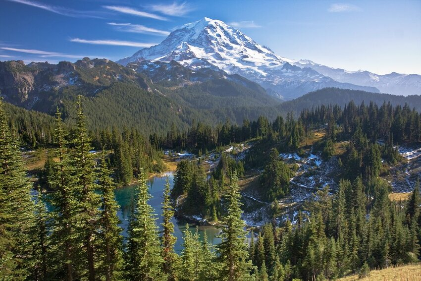 View of Mount Rainier with a dusting of snow on the lower hills.